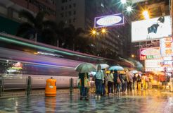 Hong Kong people waiting for the bus. HONG KONG, KOWLOON - NOVEMBER 8, 2014: Long exposure of people wait for the bus in the busy city royalty free stock photos