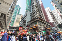Hong Kong. People walking at crowded streets with skyscrapers Stock Photo