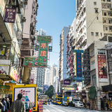 Hong Kong. People walking at crowded streets with skyscrapers Royalty Free Stock Photos