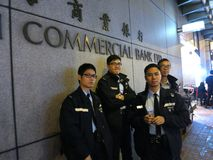Hong Kong Police Brace for Protests. Police stand ready outside a bank in Mongkok district of Hong Kong, getting ready for a protest at night. Hong Kong pan stock photo