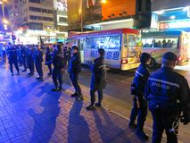 Hong Kong Police Lined Up on Road. HONG KONG, DEC. 8, 2014: Police are lined up on a road in Mongkok, Hong Kong to prevent pro-democracy protesters from royalty free stock photography