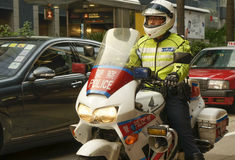 Hong Kong - Policeman on the motorcycle Royalty Free Stock Photo