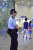 Hong Kong-politieagent op plicht Stock Afbeelding