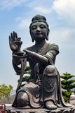 Buddhist statues praising and making offerings to the Tian Tan Buddha the Big Buddha at Lantau Island, in Hong Kong. Hong Kong is popular tourist destination of Stock Photos