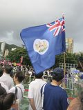 Hong Kong Protester Waving British Colonial Era Flag. An anti-government pro-democracy protester waves a British colonial-era flag at a protest in Hong Kong Stock Photography