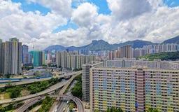 Hong kong public estate with landmark lion rock Stock Photography