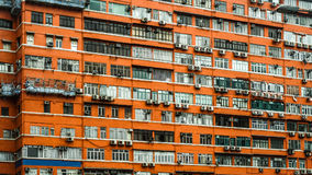 Hong Kong red apartment exterior. Old building property living space price problem Stock Image