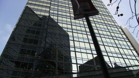 Tall glass building in Hong Kong stock video footage