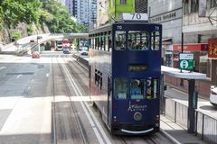 Hong Kong S.A.R. - July 13, 2017: Double decker tram or Ding Din. G on jupiter street in Causeway Bay Hong Kong. Hong Kong tram is one of the earliest forms of Royalty Free Stock Photos