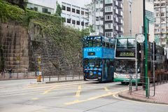 Hong Kong S.A.R. - July 13, 2017: Double decker tram or Ding Din. G on the street in Causeway Bay Hong Kong. Hong Kong tramways is one of the earliest forms of Royalty Free Stock Photo