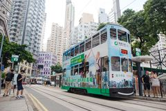 Hong Kong S.A.R. - September 22, 2017: Double decker tram on the. Street in Wan Chai.Tram or Ding Ding is major tourist attraction and one of the most Royalty Free Stock Photo