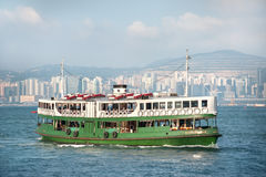 Hong Kong`s Star Ferry crossing Victoria Harbour Stock Photo