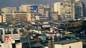 Hong Kong Sampans. HONG KONG, CHINA - CIRCA 1980: Historic colorful Chinese Sampan fishing boats with hanging clothes of the sailors in Hong Kong port. Historic stock video footage