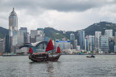 Hong Kong, SAR China - circa July 2015: Chinese junk boat sails in Victoria Harbour, Hong  Kong. Hong Kong, SAR China - circa July 2015: Chinese junk boat sails Stock Images