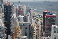 Hong Kong, SAR China - circa July 2015: Dense high rise office buildings of Hong  Kong Royalty Free Stock Photo