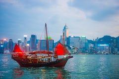 Hong Kong - September 23, 2016 :Chinese wooden sailing ship with. Red sails in Victoria harbor at Hong Kong Island, landmark Royalty Free Stock Photos