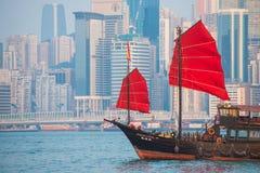 Hong Kong - September 23, 2016 :Chinese wooden sailing ship with. Red sails in Victoria harbor at Hong Kong Island, landmark Stock Images