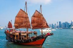 Hong Kong - September 23, 2016 :Chinese wooden sailing ship with. Red sails in Victoria harbor at Hong Kong Island, landmark Stock Photography