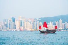 Hong Kong - September 23, 2016 :Chinese wooden sailing ship with. Red sails in Victoria harbor at Hong Kong Island, landmark Royalty Free Stock Images