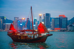 Hong Kong - September 23, 2016 :Chinese wooden sailing ship with. Red sails in Victoria harbor at Hong Kong Island, landmark Royalty Free Stock Image