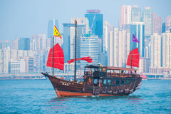 Hong Kong - September 23, 2016 :Chinese wooden sailing ship with. Red sails in Victoria harbor at Hong Kong Island, landmark Royalty Free Stock Photography