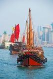 Hong Kong - September 23, 2016 :Chinese wooden sailing ship with. Red sails in Victoria harbor at Hong Kong Island, landmark Stock Image