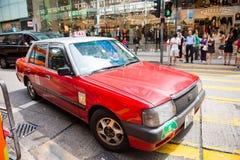 Hong Kong - September 22, 2016: Rode taxi op de weg, Hong Kong ' Stock Fotografie