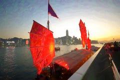 Hong Kong. A ship with red sails stop at Tsim Sha Tsui in Victoria Harbour, Hong Kong Royalty Free Stock Photo