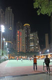 Hong Kong sky scrapers and sports playground by night Stock Images