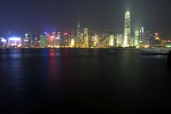 Hong Kong Skyline. At a distance.  Long exposure blurred water Royalty Free Stock Photos