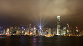 Hong Kong Skyline. The Hong Kong skyline during the Symphony of Lights, Hong Kong's nightly laser light show.  Buildings are decorated with holiday lights for Stock Photo