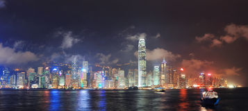 Hong Kong skyline. Panorama at night with clouds over Victoria Harbour royalty free stock images