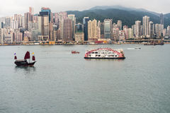 Hong Kong skyline with antique junk boat Stock Photo