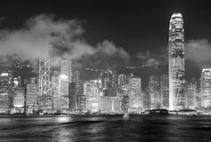 Hong Kong skyline black and white. Hong Kong skyline at night with clouds over Victoria Harbour in black and white stock images