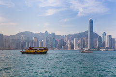 Hong Kong skyline with boats in Victoria Harbor Royalty Free Stock Photo