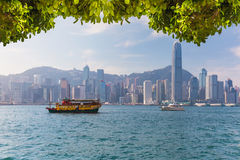Hong Kong skyline with boats in Victoria Harbor Stock Photo