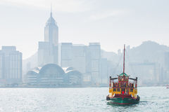 Hong Kong skyline with boats in Victoria Harbor Stock Photography