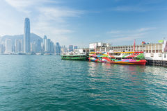 Hong Kong skyline with boats in Victoria Harbor Royalty Free Stock Photos