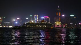 Hong Kong skyline. Hong Kong, China - January 1, 2016: Hong Kong with ferry boat from waterfront of Tsim Sha Tsui in Kowloon. On background the landmarks Central stock footage