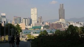 Hong Kong skyline at daytime over Victoria Harbour stock video footage