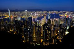 Famous Hong Kong blue Skyline at evening night from the peak of Tai Ping mountain stock photography
