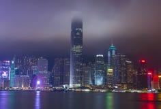 Hong Kong skyline at a foggy night. HONG KONG - MARCH 06 : The Hong Kong skyline at a foggy night on March 06 2018 Stock Photos