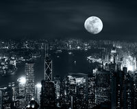 Hong Kong skyline at full moon night Royalty Free Stock Photography