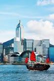 Hong Kong skyline with junk Stock Photo