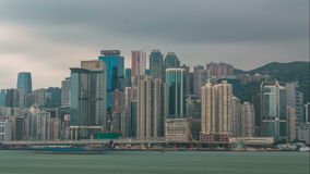 Hong Kong skyline in the morning over Victoria Harbour timelapse. stock video footage