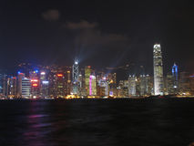Hong Kong skyline at night. The skyline of Hong Kong island, seen from Victoria Harbour, during the Symphony of Light - a spectacular display royalty free stock photography