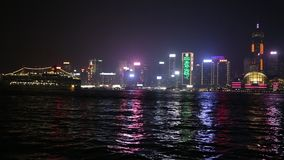 Hong Kong skyline by night. Hong Kong, China - January 1, 2016: night cityscape with ferry boat from the waterfront of Tsim Sha Tsui in Kowloon with Central stock video footage