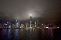Hong Kong Skyline by night, China. Stormy clouds lit up as they touch the skyscrapers, Hong Kong, China royalty free stock photo