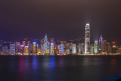 Hong Kong skyline by night. Illuminated skyline of Hong Kong by night with colorful reflections in the sea. Logos not recognizable Royalty Free Stock Image