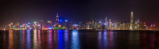 The Hong Kong Skyline at night. The Hong Kong Skyline shines over the kowloon Royalty Free Stock Image